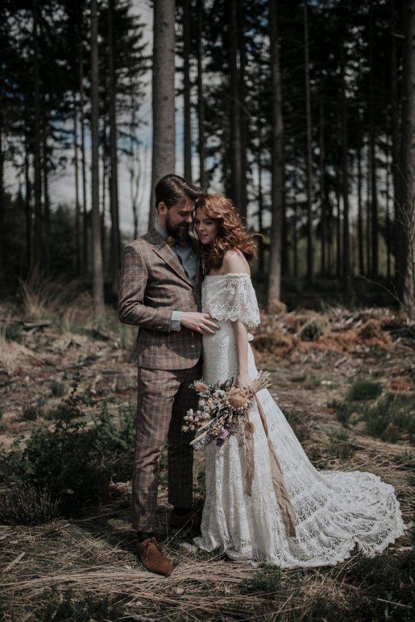 a chic boho lace off the shoulder sheath weddding dress with a small train for a fall boho bride