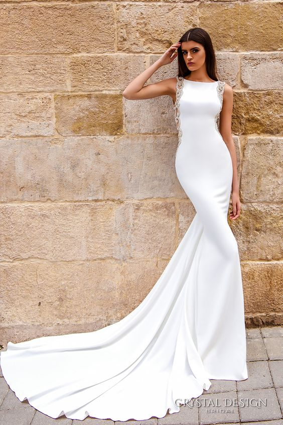 Picture Of A Modern Sheath Wedding Dress With Bateau Neckline Embellished Sides And Train
