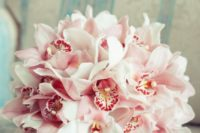 05 a simple and beautiful bouquet of pink orchids for a gorgeous and bold look