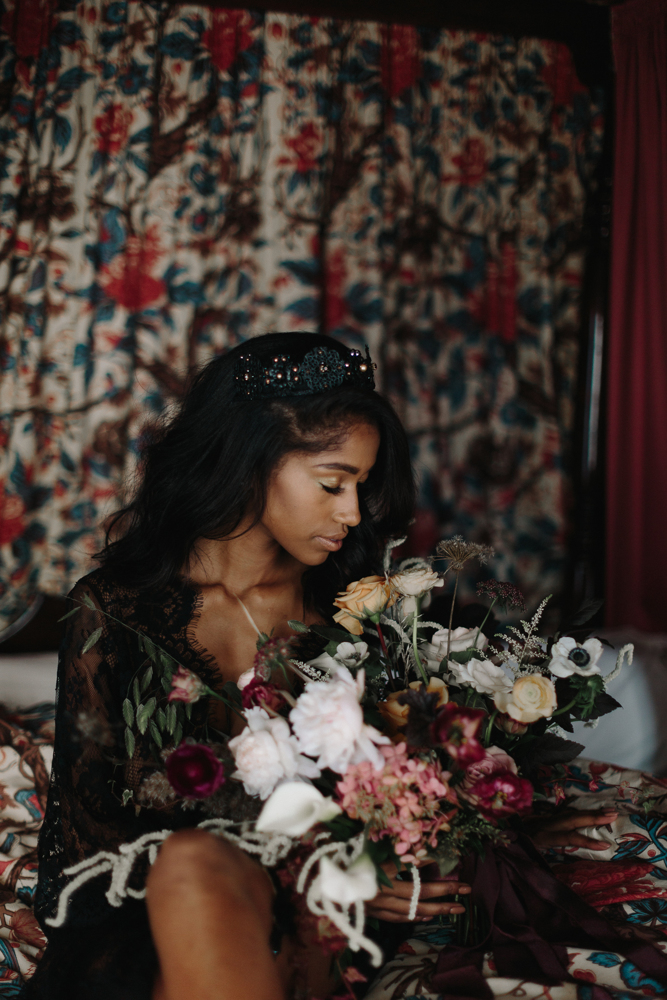 The bride showed off a fantastic sparkly black headpiece and a black lace gown