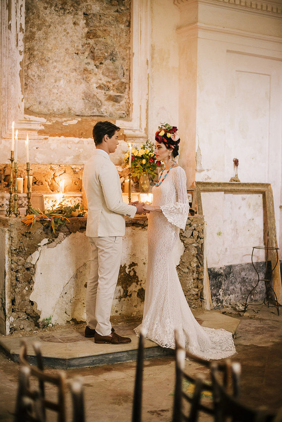 The ceremony too place next to a shabby altar decorated with candles and blooms