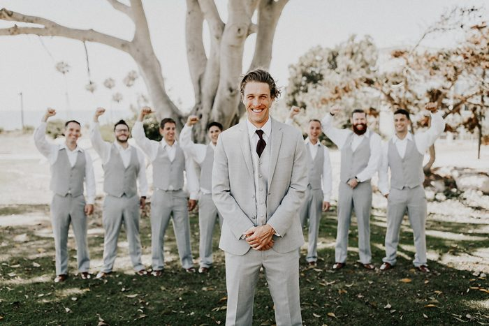 The groomsmen were rocking light grey suits with vests