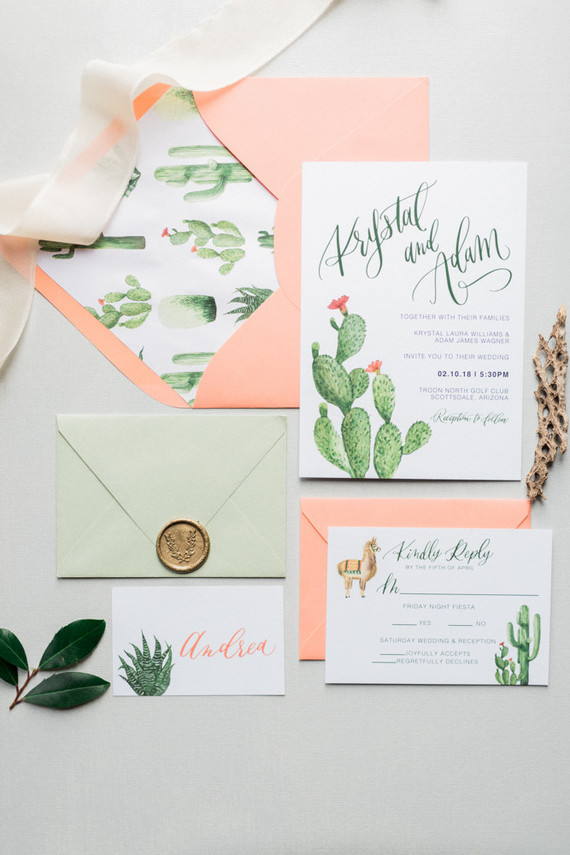 The wedding invitations were inspired by the location, which is a desert, so you can see cacti and alpacas