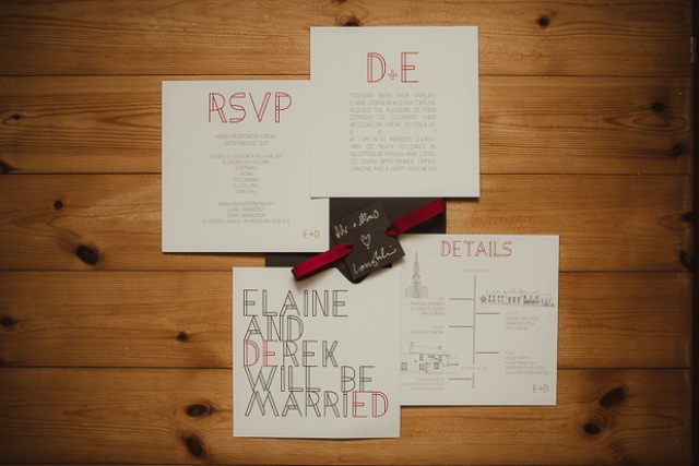 The wedding invites were done by the groom in black and red