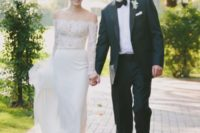 06 a chic sheath off the shoulder wedding dress with a lace bodice with long sleeves and a plain skirt plus a sparkling belt