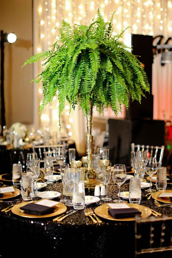 a lush and tall fern wedidng centerpiece is great not only for tropical but for glam and art deco weddings, too