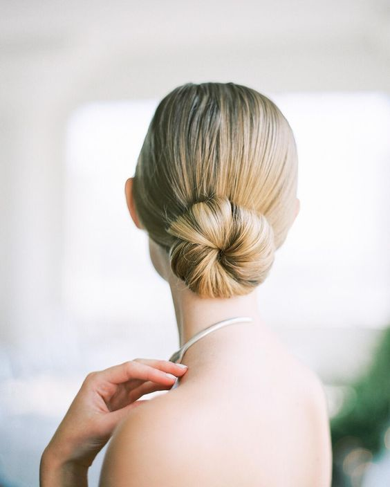 a minimalist sleek ballet bun is a chic statement for a minimal bride to rock on a big day