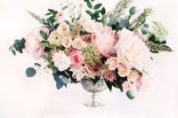 06 a super lush and textural floral centerpiece with blush, pink and white blooms, herbs and greenery