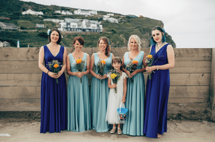 The bridesmaids were wearing aqua and bold blue thick strap dresses with V-necklines