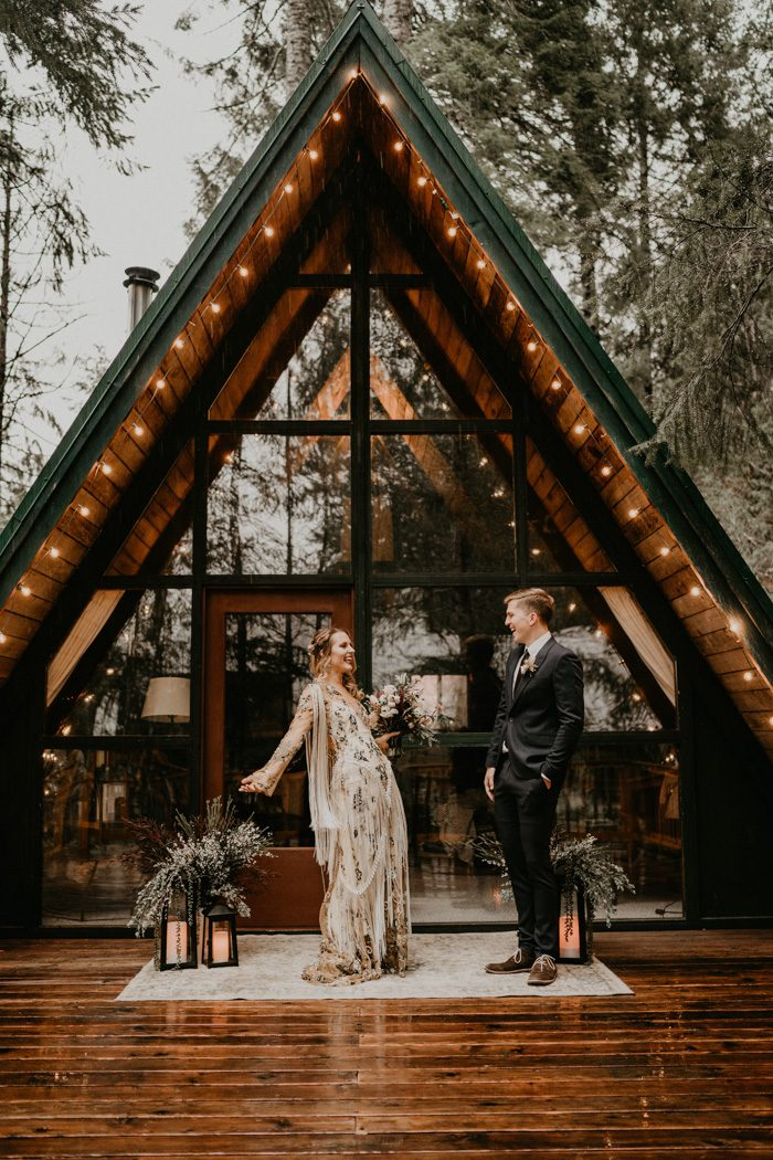 The couple was having a ceremony in front of the cabin, the space was done with candle lanterns and a rug