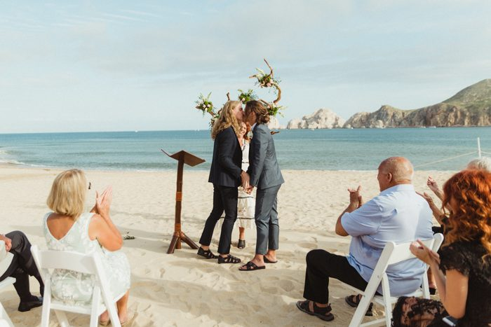 The grooms shared love in front of the ocean