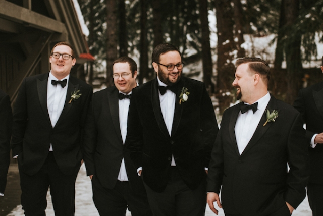 The groomsmen were wearing black tuxedos