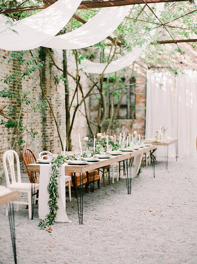 The reception space was done with vintage industrial tables, with airy fabric hanging from above