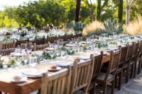 wedding tables with greenery as table runners