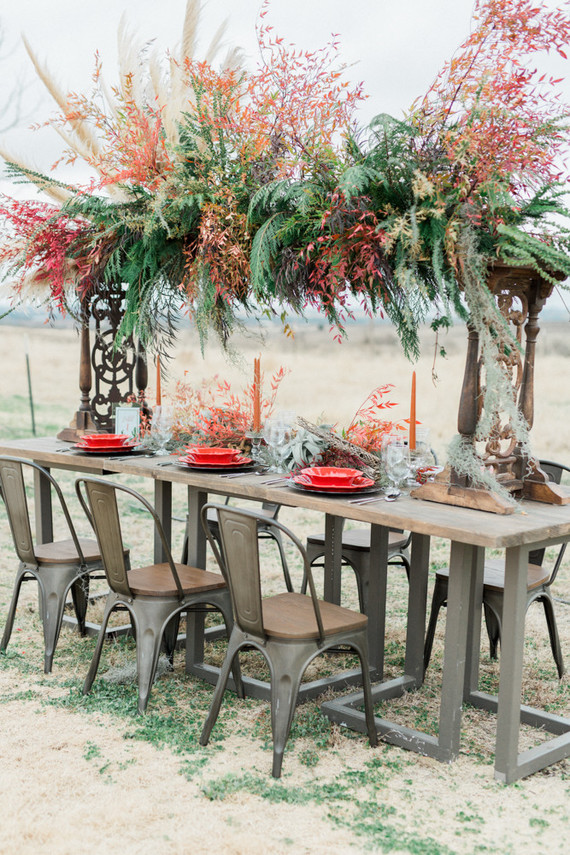 The wedding tablescape stroke at once with a bold overhead greenery and herb decoration, which is lush and catchy