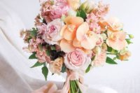07 a beautiful and sweet pastel bouquet of pink garden roses and peachy orchids for a spring or summer bride