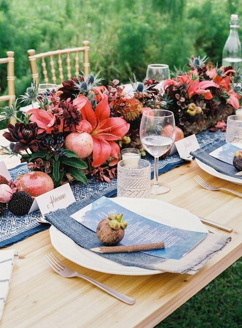 a bold and lush tropical table runner with tropical blooms and fruits and berries for a bold and textural touch