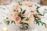 07 a pastel blush floral centerpiece with a couple of greenery touches looks very delicate and soft