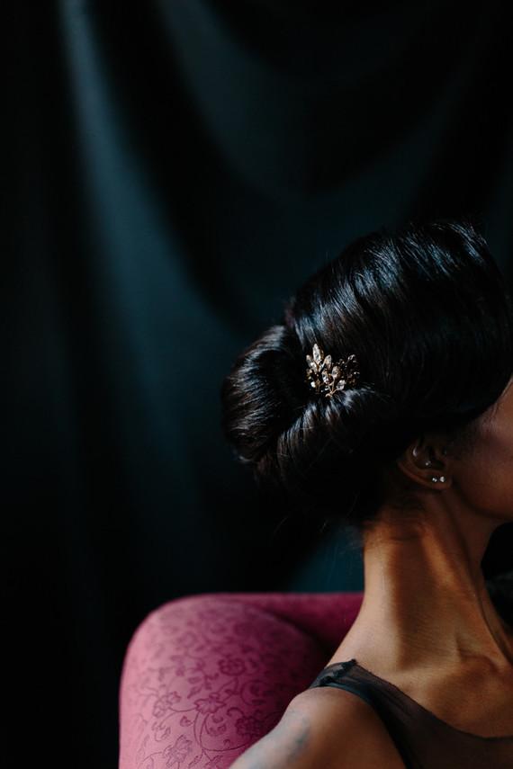 Her hair was done in an elegant sleek way, with a little rhinestone harpiece