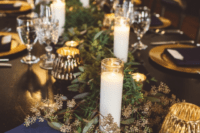 08 Lush eucalyptus table runners enlivened the tables and pillar candles created a cozy ambience