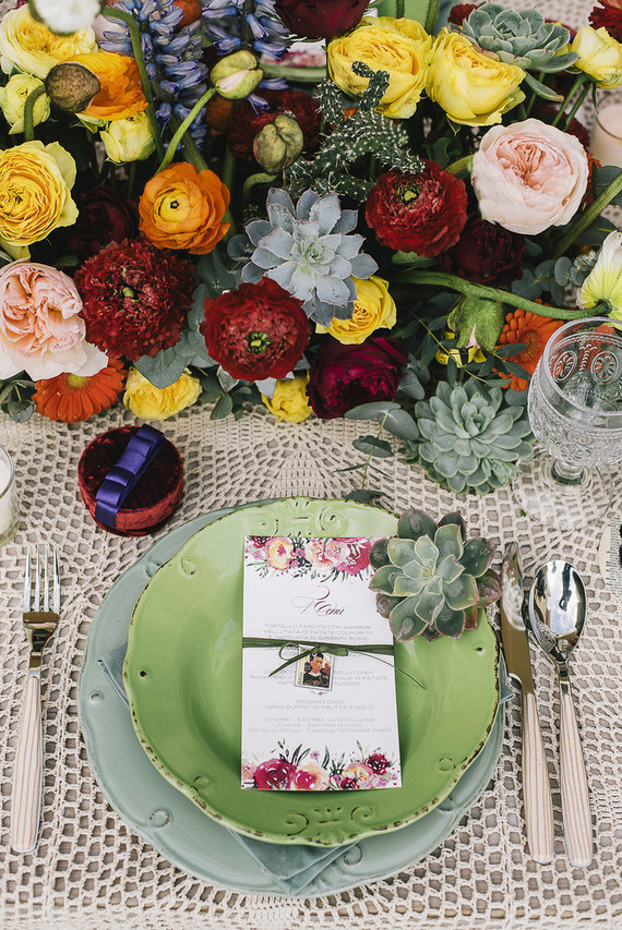 Shabby chic plates and chargers added texture, and lush colroful florals and succulents screamed Mexico