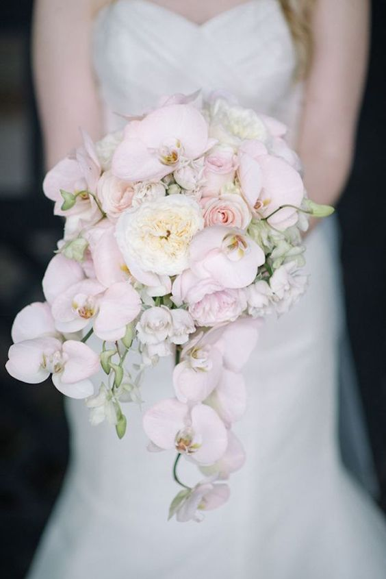 a cascading bouquet with blush orchids and white peonies for a cool look