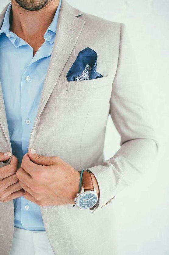 a creamy windowpane suit, a blue shirt and a handkerchief for a coastal groom's look