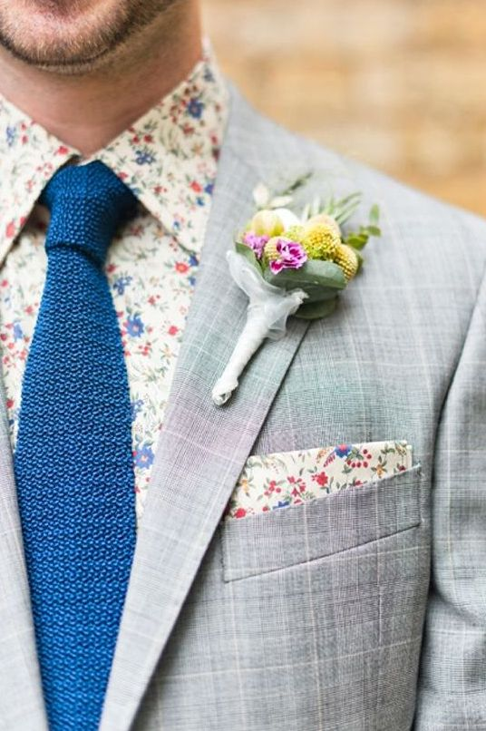 a grey windowpane suit, a floral shirt and handkerchief, a bold blue tie