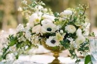 08 a lush and cascading white wedding centerpiece with various blooms and greenery