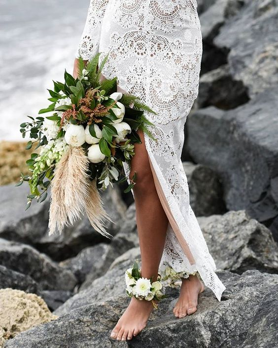 white bloom and greenery anklets match the wedding bouquet and are perfect for a boho coastal bride