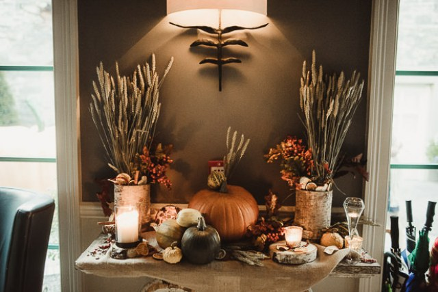 The decor was inspired by harvest - look at these pumpkins, wheat, leaves and berries plus candles