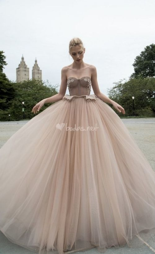 a gorgeous taupe princess-style ballgown with a corset-styled bodice and a layered full skirt