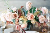 09 a pastel wedding centerpiece with blush and light-colored mauve blooms with greenery