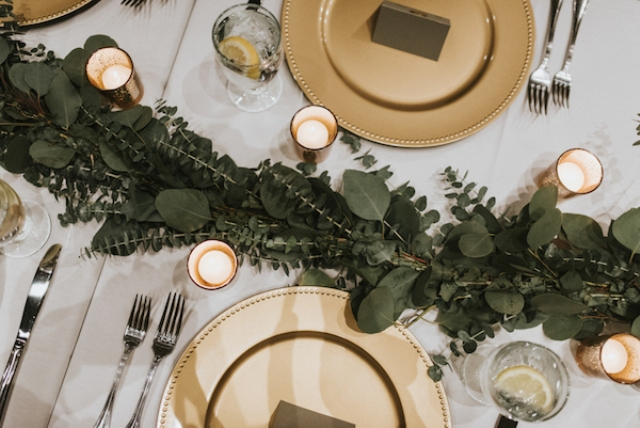 Gold chargers and eucalyptus table runners added glam to the space