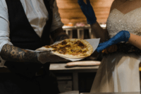10 The couple participated in cooking pizza for the guests
