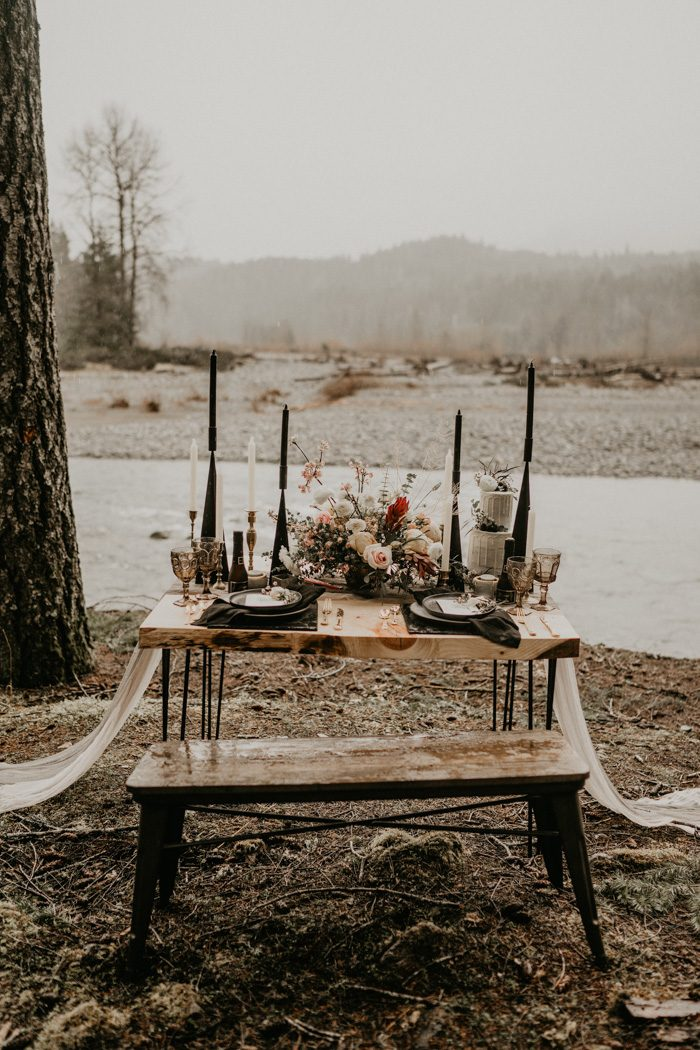 The table was styled with a textural centerpiece, black geometric candle holders, black chargers and plates