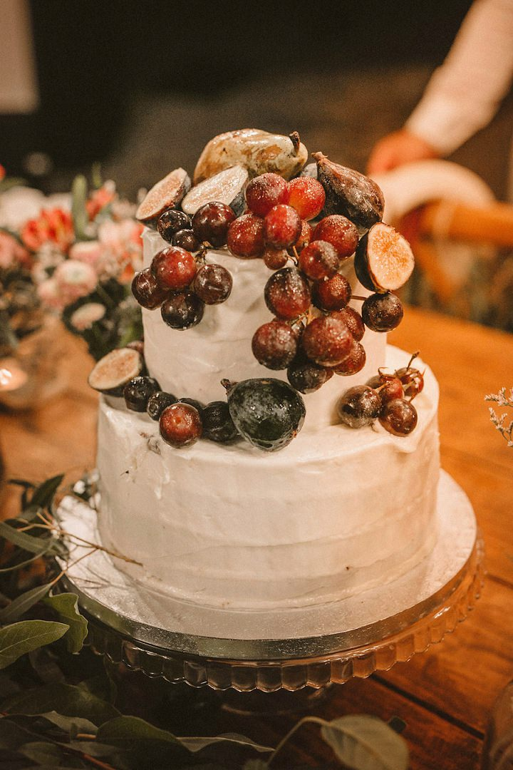 The wedding cake was a white one for a rustic touch, it was topped with grapes and figs