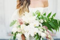 10 a chic cascading bouquet with white and light pink orchids and greenery for a romantic feel