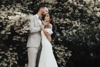 10 a gorgeous mermaid off the shoulder wedding dress with a lace trim and a long train for an ethereal look