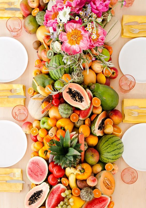 a super lush table runner of every kind of tropical fruit wows and can be eaten by the guests