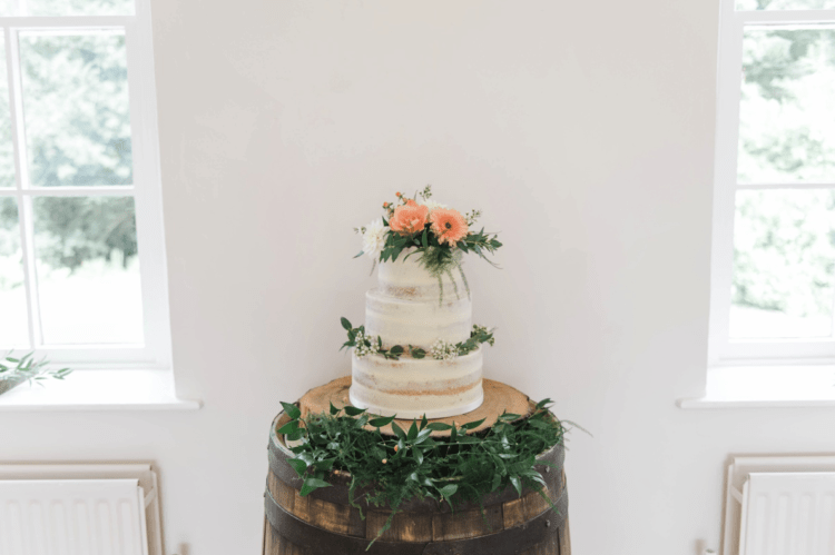 The wedding cake was a naked one decorated with greenery and blooms