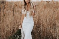 11 a lace off the shoulder mermaid wedding dress with a small train and a floral crown for a summer boho bride