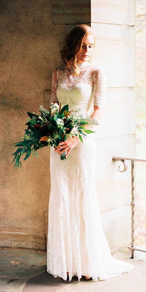 a lace sheath wedding dress with short sleeves, an illusion neckline for a modest and romantic bride