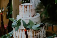 12 The wedding cake was a white buttercream one, with chocolate drip, greenery and plush flamingo toppers