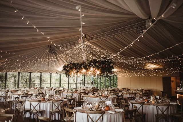 The wedding reception was beautifully lit up and looked very cozy, there were many guests - 180