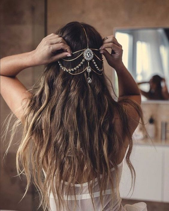 long waves down accented with a jeweled chain that looks boho and a bit gypsy like