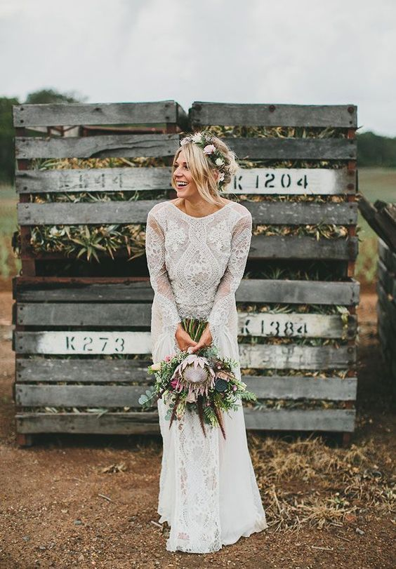a boho lace wedding dress with long sleeves and a high neckline by Grace Loves Grace