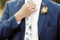 13 a chic groom look with a slate grey suit, a white shirt and a light-colroed floral print tie
