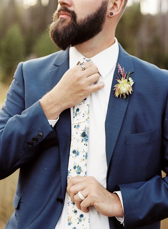 a chic groom look with a slate grey suit, a white shirt and a light colroed floral print tie