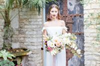 13 a plain fit and flare off the shoulder wedding dress with lace detailing and small train